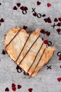 a coconut macaroon heart with a bite taken out