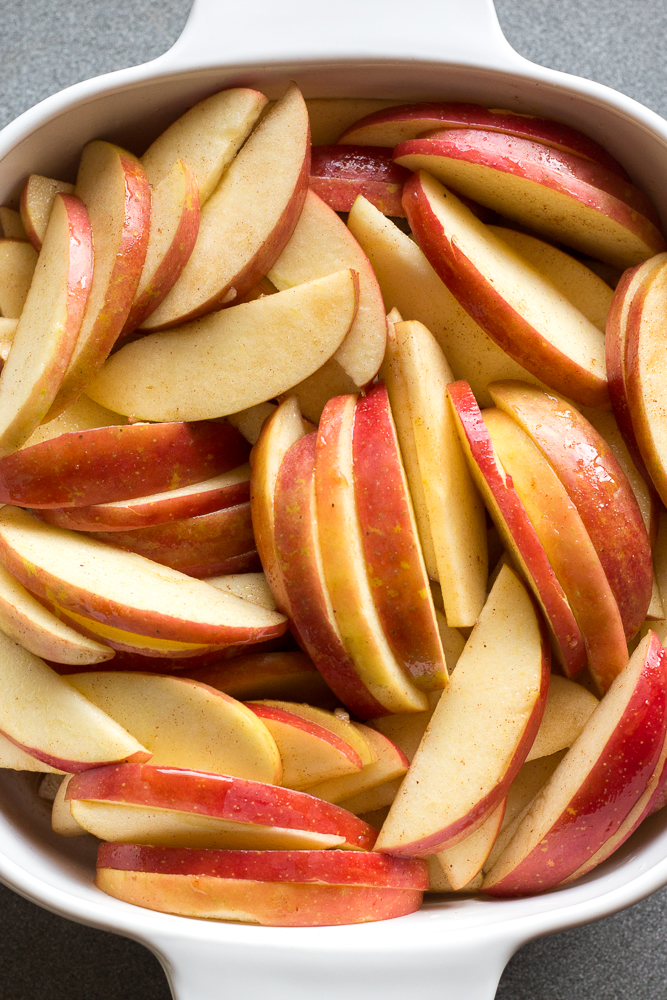 apple slices in a white baking dish
