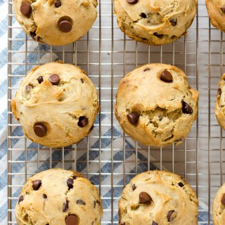 top down shot of banana chocolate chip muffins on a wire rack