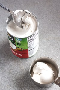 scooping coconut cream out of a can