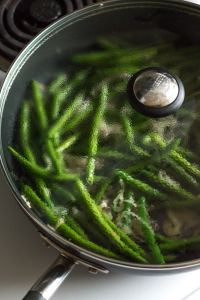 green beans and shallots in a covered pan