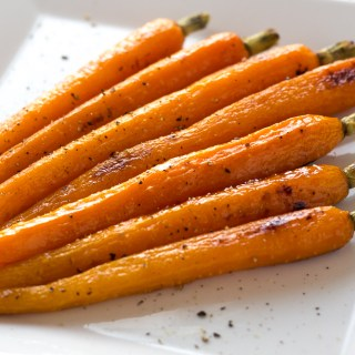 honey roasted carrots on a white plate