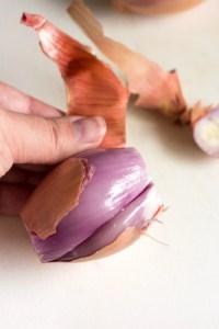 peeling skin off a shallot