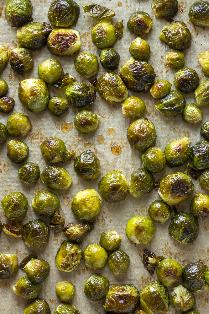 cooked maple roasted brussels sprouts on a sheet pan