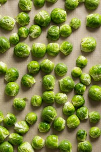 cut brussels sprouts on a sheet pan