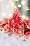 a piece of white chocolate peppermint bark standing up