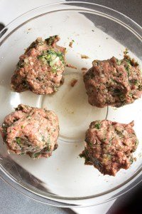 paleo meatloaf muffin mixture separated into 4 sections in a bowl
