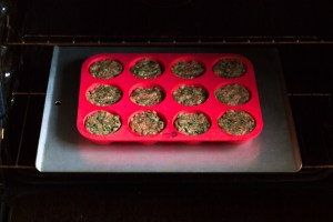 muffin tin with paleo meatloaf muffins going into oven