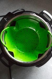 green colander in instant pot insert