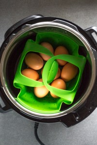 eggs in a green colander in instant pot