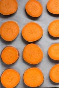 sliced sweet potato on sheet pan