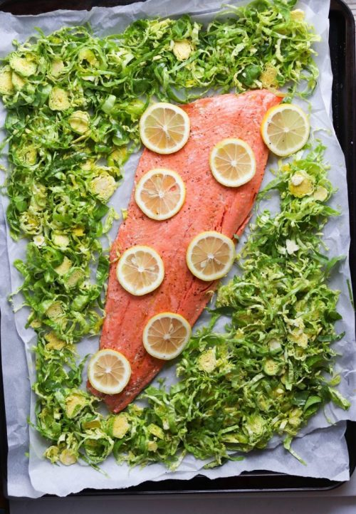 salmon with lemons and brussels sprouts on a sheet pan