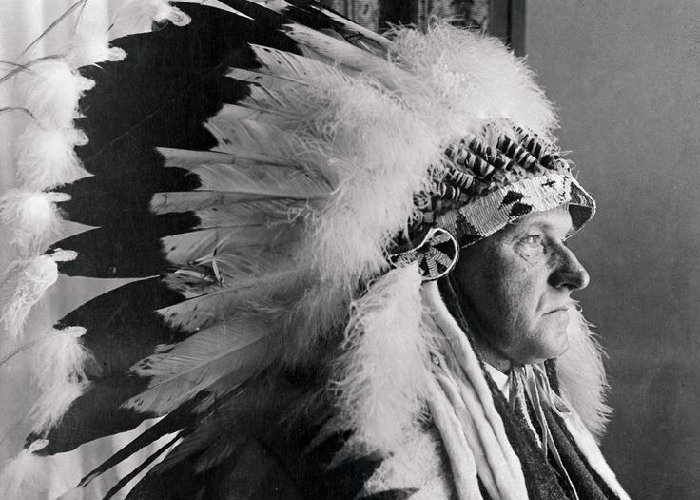 Calvin Coolidge in native american headdress