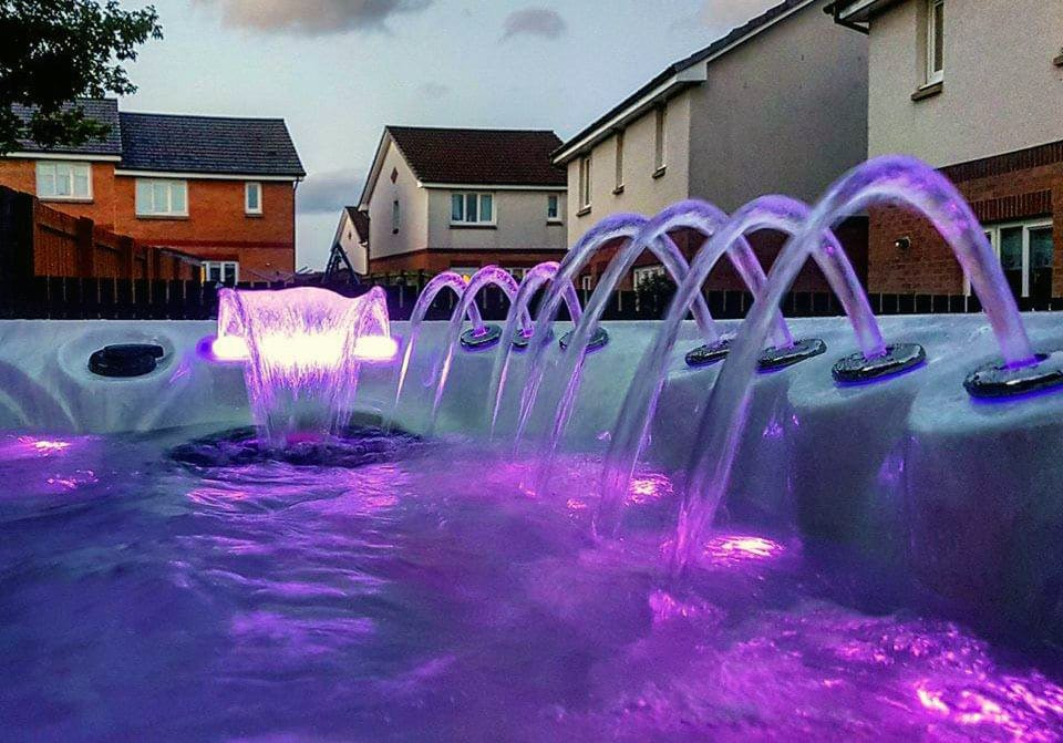 Hot Tub with purple LED lights at the evening