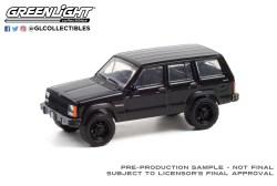 GreenLight-Collectibles-Black-Bandit-25-1990-Jeep-Cherokee