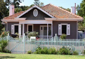 Home with white picket fence