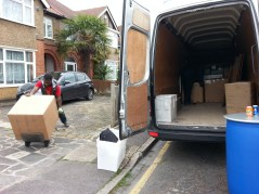 The van is loaded after the boxes are packed.