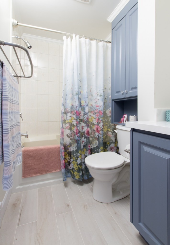 Painted cabinets floral shower curtain kids bathroom