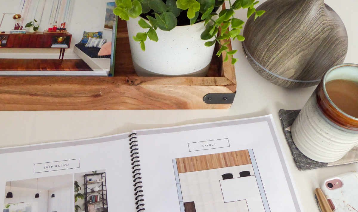 An e-design plan on a coffee table