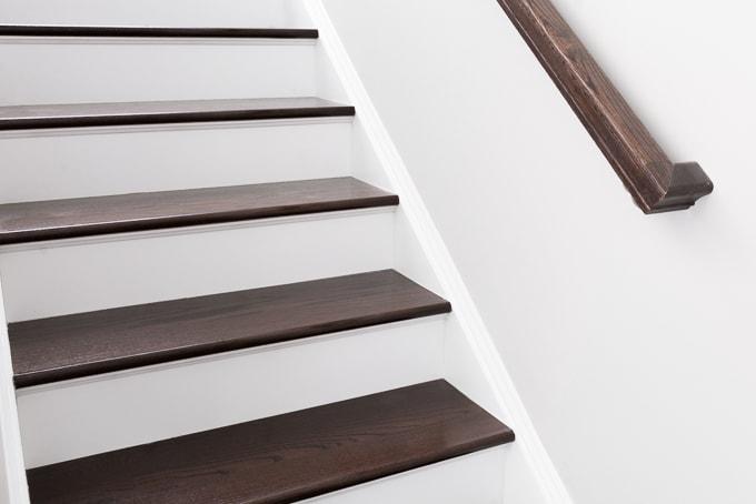 How to Re-caulk Cracked Stair Stringer Seams // Re-caulking Stair Trim