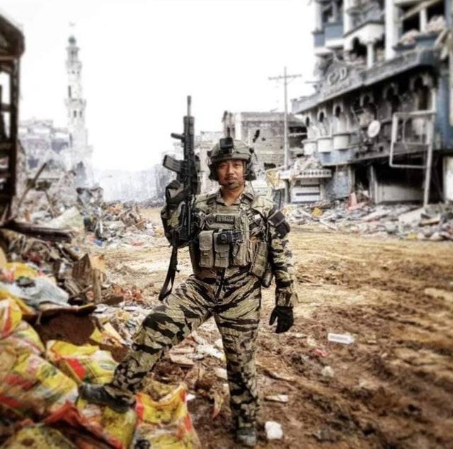 Philippine SOF soldier in modern tiger stripe camo.