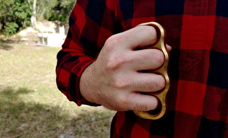 flannel shirt and brass knuckles