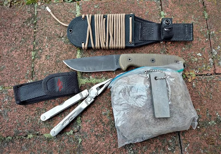 The TAK is a part of a fire starting kit, including a multi tool dryer lint, and ferocium rod.