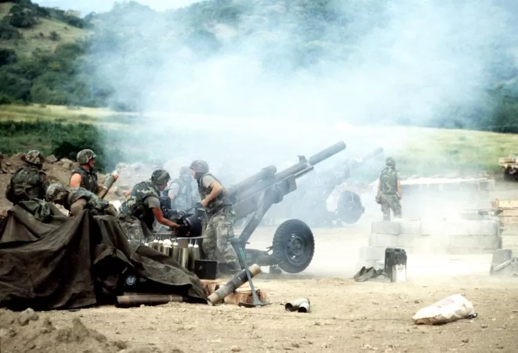 M102 howitzers of 1st Bn 320th FA, 82D Abn Div firing during Operation Urgent Fury – the invasion of Grenada in 1983. Soldiers in BDU M81 woodland camo.