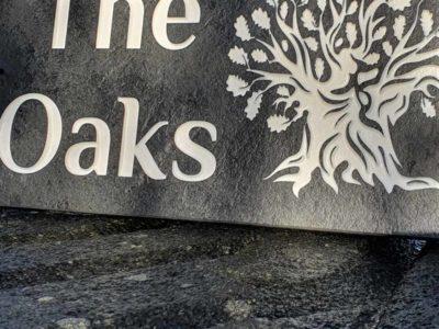 The Oaks slate plaque in Philosopher Bold font closeup
