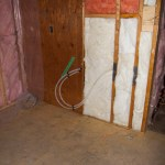 Insulation and bathtub plumbing in the bathroom.
