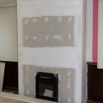 Fireplace, drywalled, ready for paint and then the mantle!