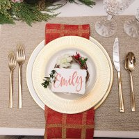 A CLASSIC RED AND GOLD CHRISTMAS TABLESETTING