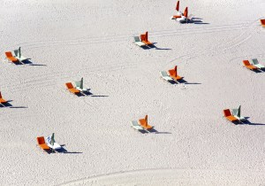 Miami Beach orange chairs by Gray Malin