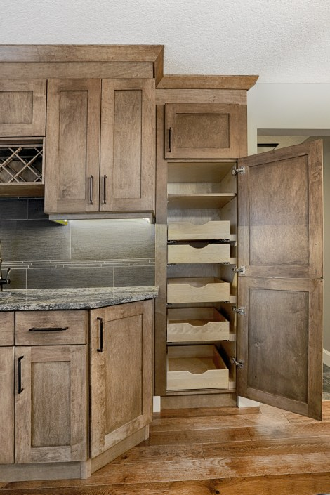 Custom built cabinetry with pull-out pantry. By House of J Interior Design. Edmonton, Alberta.