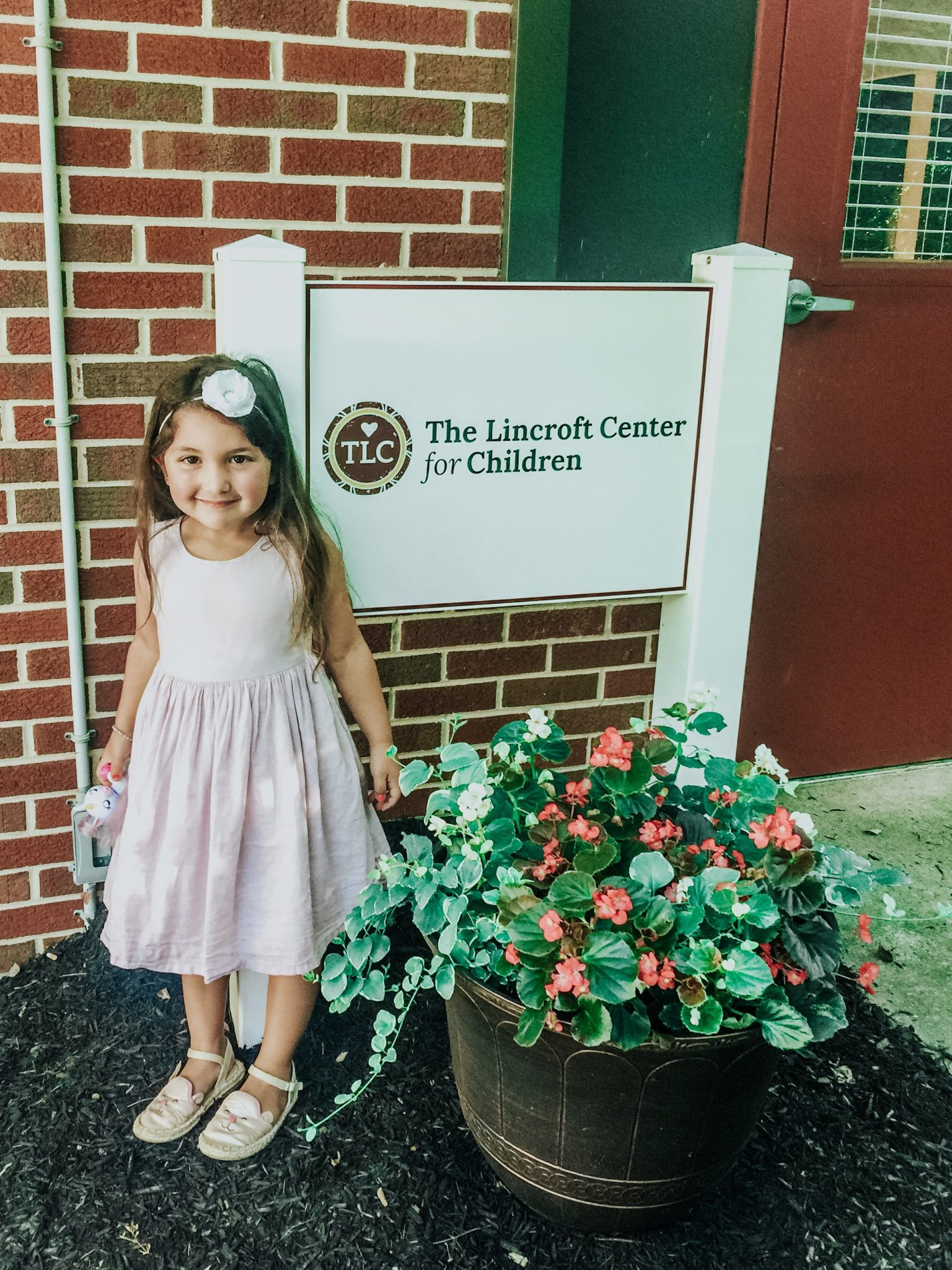 Top New Jersey lifestyle blog, House of Leo, honors the daycare mom and shares their thoughts on the difficult decision to make to go back to work: image of the lincroft center for children
