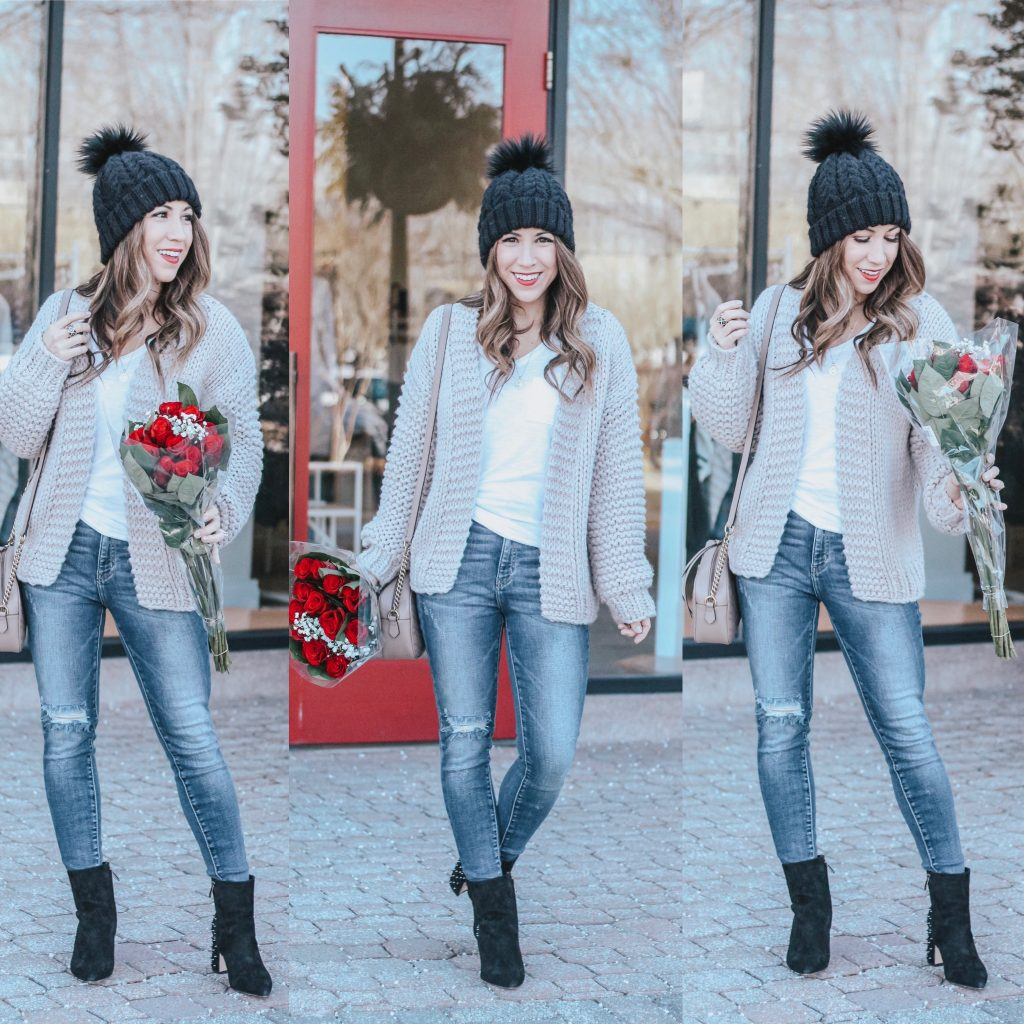 Cute Valentine's Day Sweaters featured by top US fashion blog House of Leo Blog; Image of a woman wearing Chicwish sweater, Red Dress Boutique jeans and Amazon boots.