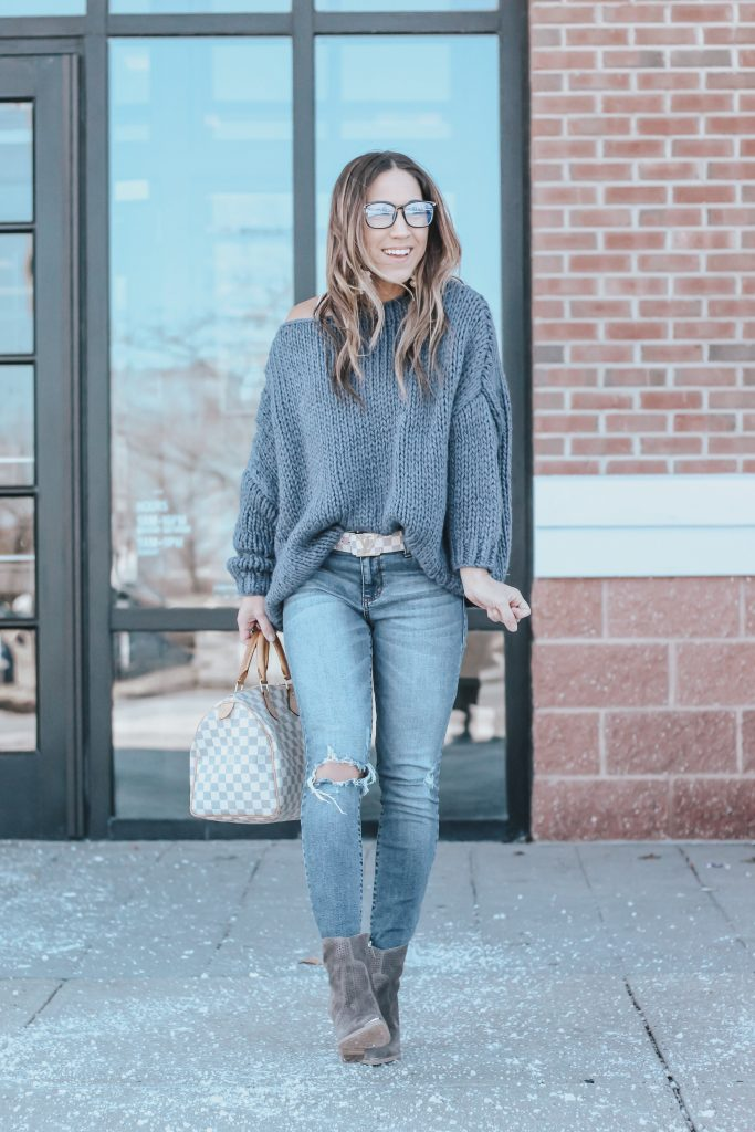 Spring Booties featured by top US fashion blog House of Leo Blog; Image of a woman wearing Chicwish sweater, Marc Fisher boots and Nordstrom jeans.