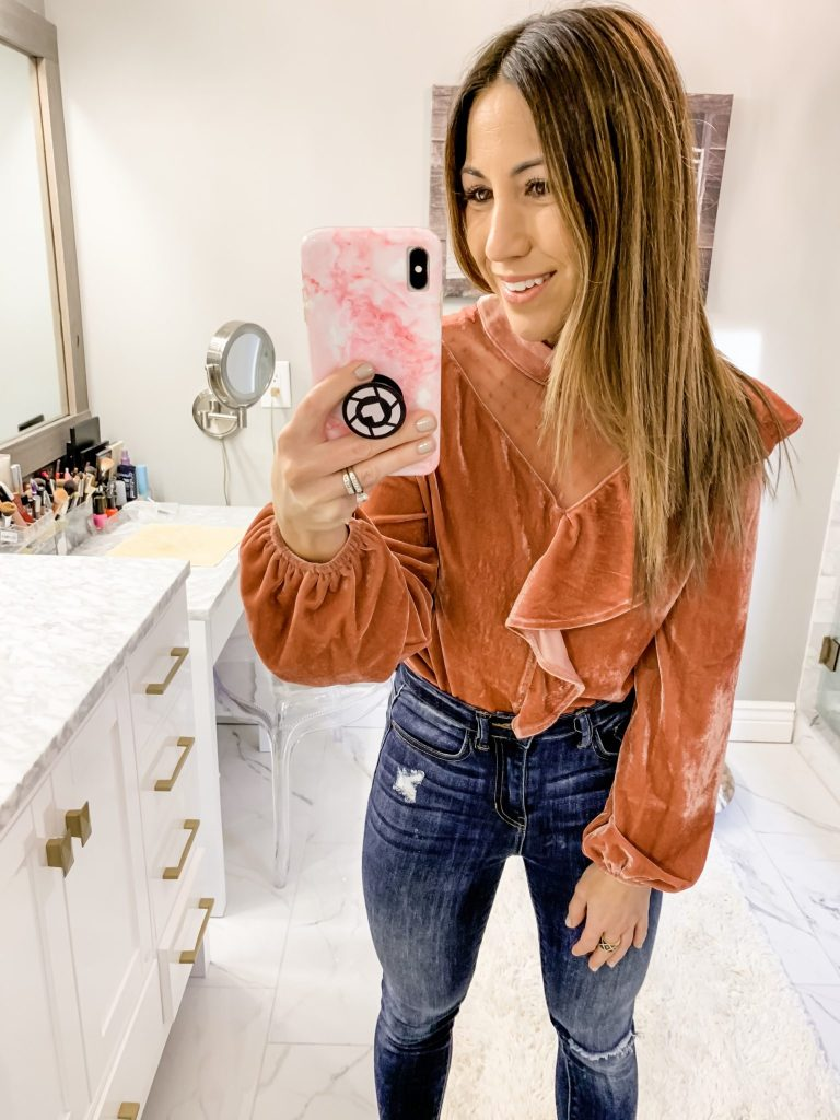 SheIn Haul by top US fashion blog, House of Leo Blog: image of a woman wearing a velvet ruffle top