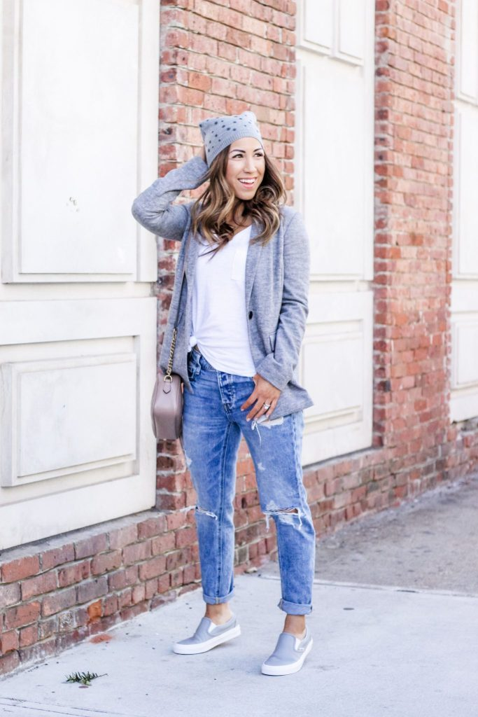 Latest Spring Fashion with Yoox by top US fashion blog, House of Leo Blog: image of a woman wearing a gray blazer by Armani Jeans, gray VANS sneakers, Bart's beanie and American Eagle tomgirl jeans