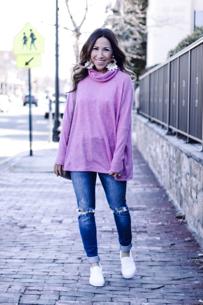AFFORDABLE SWEATERS TO WEAR NOW FROM RED DRESS BOUTIQUE by top US fashion blog, House of Leo Blog: image of a woman wearing a pink turtleneck from Red Dress Boutique