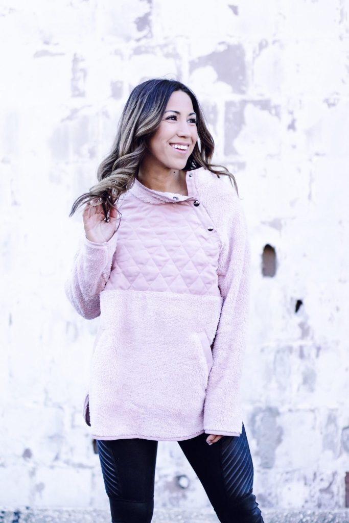 AFFORDABLE SWEATERS TO WEAR NOW FROM RED DRESS BOUTIQUE by top US fashion blog, House of Leo Blog: image of a woman wearing a pink fleece pullover from Red Dress Boutique and Spanx moto leggings
