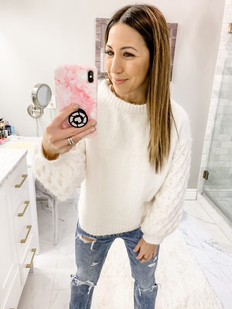 SheIn Haul by top US fashion blog, House of Leo Blog: image of a woman wearing a white chunky sweater and American Eagle tomgirl jeans