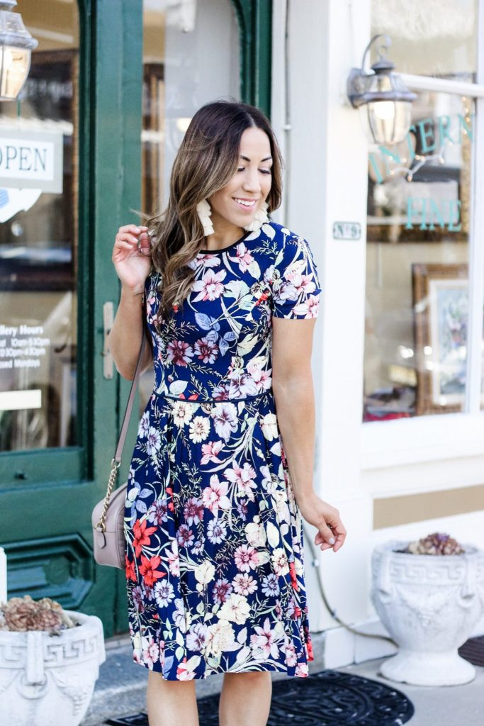 $58 Dresses at Maggy London by top US fashion blog, House of Leo Blog: image of a woman wearing the Maggy London Sloane dress