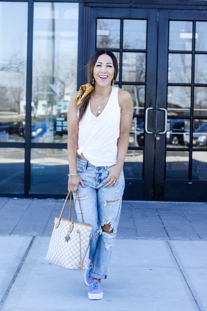 10 MUST HAVE ITEMS TO ADD TO YOUR CLOSET THIS SPRING by top US fashion blog, House of Leo Blog: image of woman wearing Express white tank, American Eagle boyfriend jeans and Vans blue platform sneakers, Louis Vuitton Neverfull Damier Azure bag