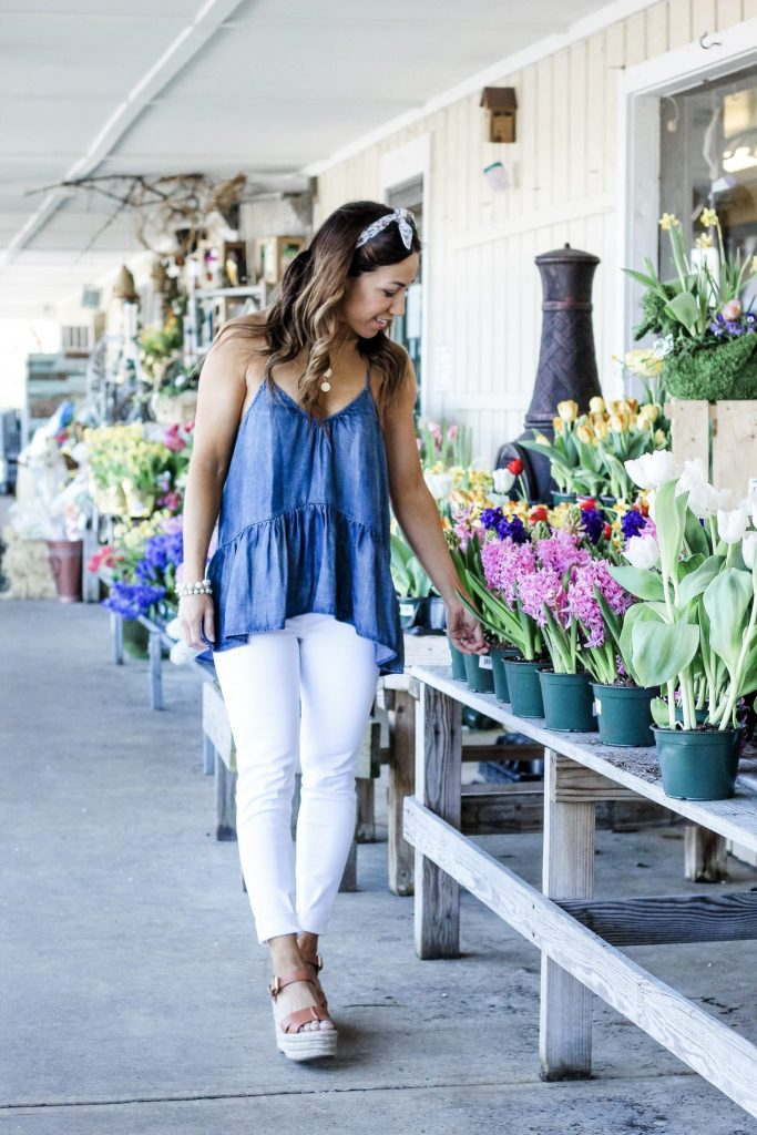 Cute Spring Outfits from Red Dress Boutique by top US fashion blog, House of Leo Blog: image of woman wearing a denim peplum top and white denim jeans