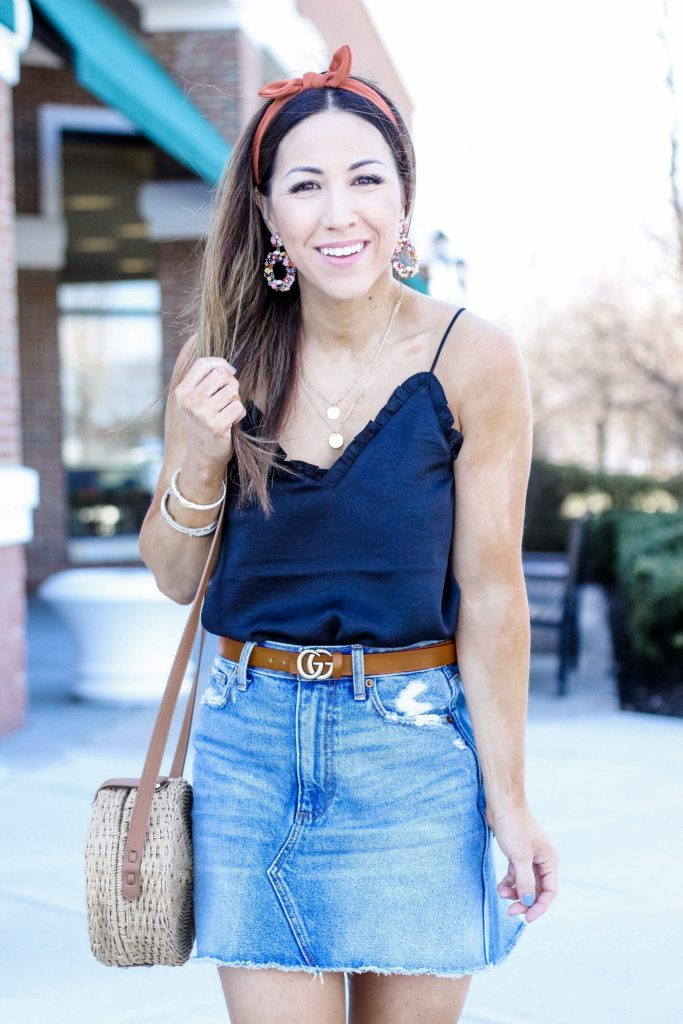 10 MUST HAVE ITEMS TO ADD TO YOUR CLOSET THIS SPRING by top US fashion blog, House of Leo Blog: image of woman wearing Abercrombie denim skirt, Marc Fisher Rex leopard espadrilles, black cami and straw circle bag