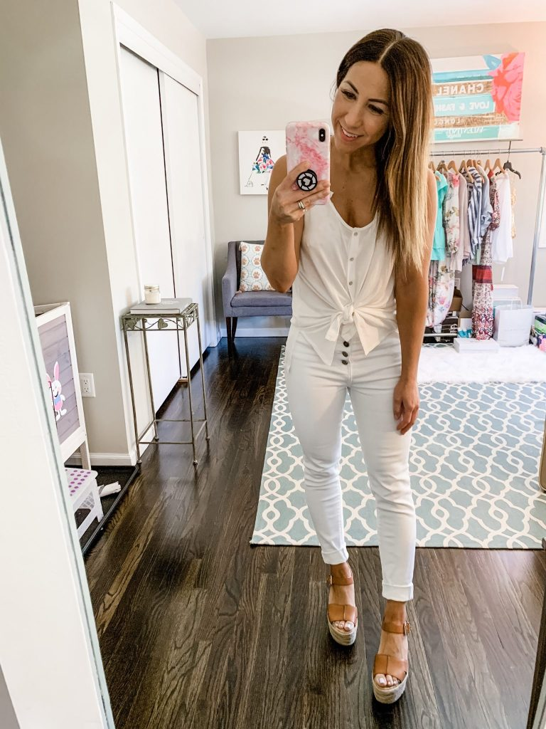 Cute Spring Outfits from Red Dress Boutique by top US fashion blog, House of Leo Blog: image of woman wearing a white tan top and white denim