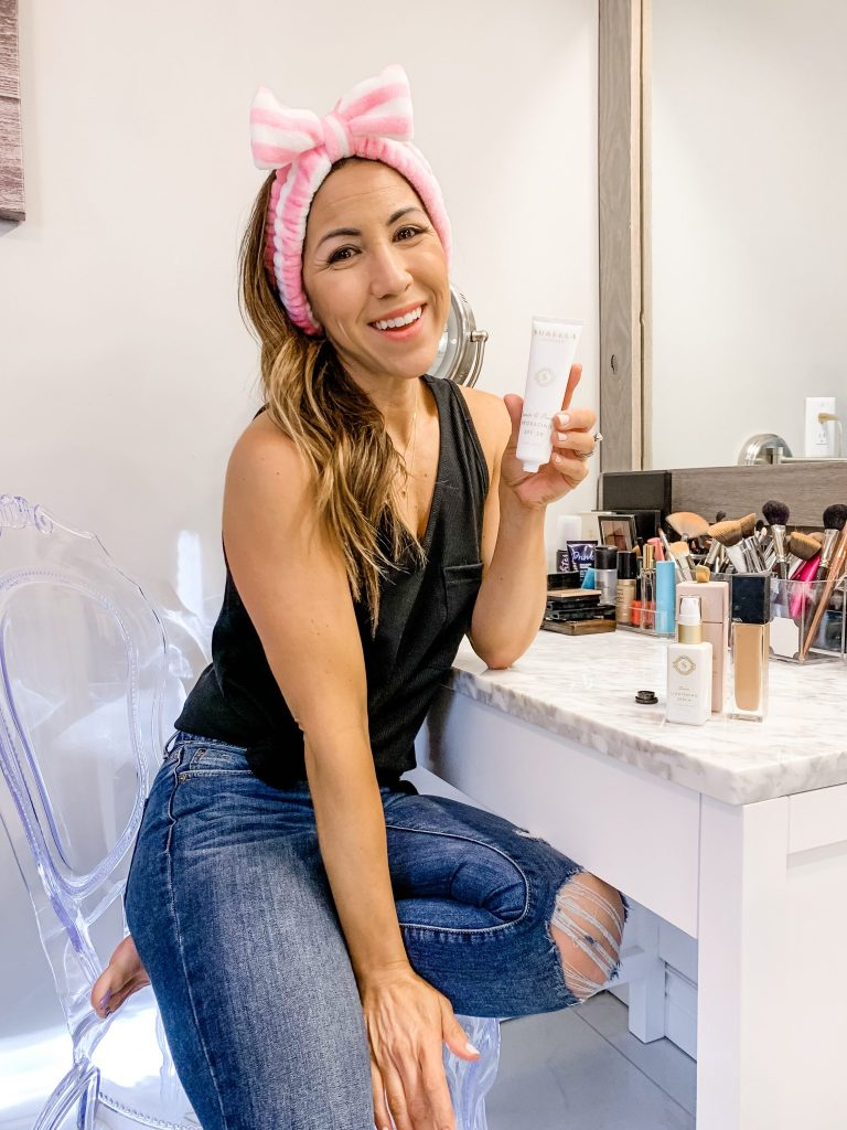 2 Must Have Skincare Products For Summer by top US beauty blog, House of Leo Blog: image of woman using Art of Skin Care Sorella Apothecary Quench & Protect Hydrating SPF 30
