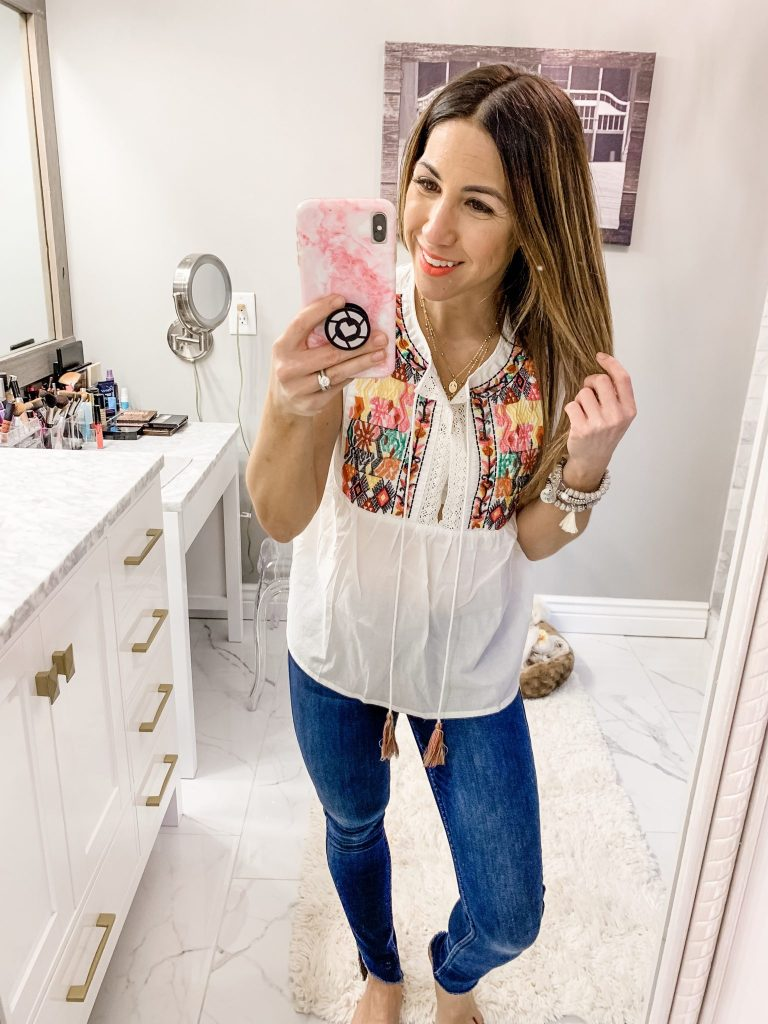 Amazon Haul by top US fashion blog, House of Leo Blog: image of woman wearingFloerns Sleeveless Ruffle Striped Embroidered Pom Pom Tie Neck Blouse