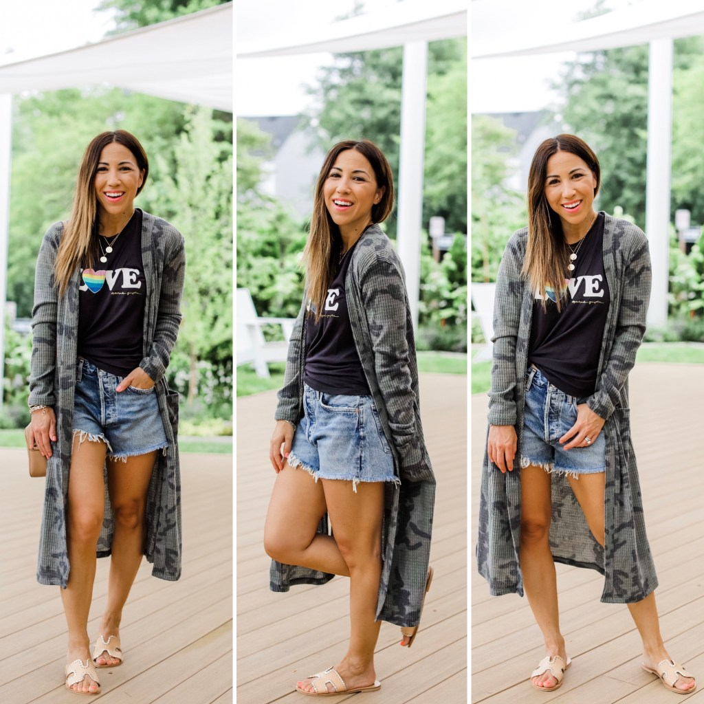 Evereve 4th of July Sale by top US fashion blog, House of Leo Blog: image of woman wearing camo cardigan, agolde denim shorts, LOVE graphic tank, steven greece slides